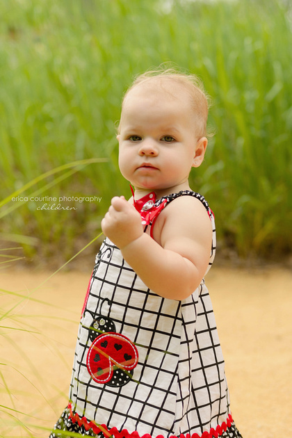 A little girl plays at White Deer Park in Garner, near Raleigh, NC during her first birthday photography session.