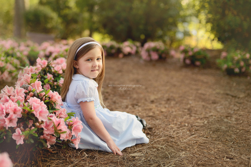 A little girl sits during a photography session at WRAL Azalea Garden in Raleigh NC.  Raleigh Cary Apex Family Photographer