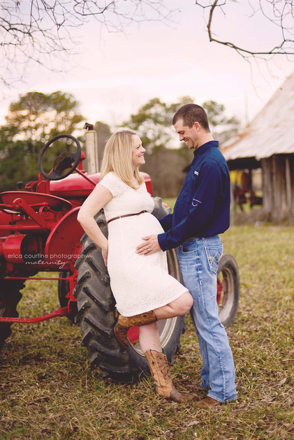raleigh cary holly springs apex nc newborn photographer captures a maternity portrait on a family farm with a farmall red antique tractor