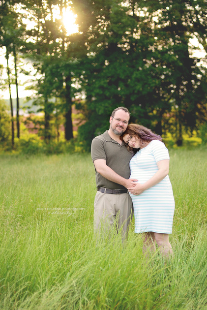 maternity portraits in a grassy meadow at sugg farm in holly springs.  holly springs maternity and newborn photographer