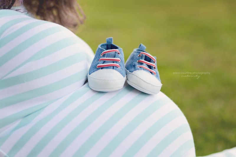 A maternity portrait session in holly springs outside of raleigh nc.  Little blue shoes on a belly.  raleigh newborn photographer