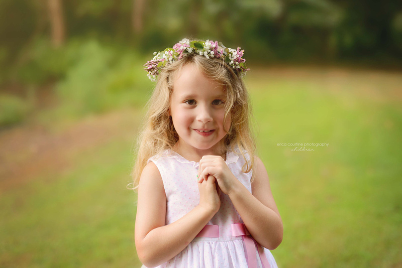 A little girl with a floral halo during a photography session in fuquay varina nc.
