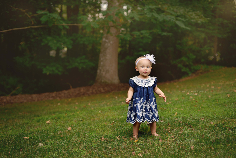 Baby playing in the yard during a portrait session by raleigh family photographer Erica Courtine.