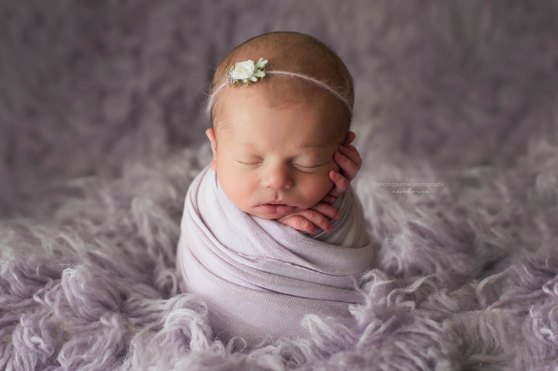 A baby girl during a newborn portrait session in a Fuquay Varina studio with Erica Courtine Photography.