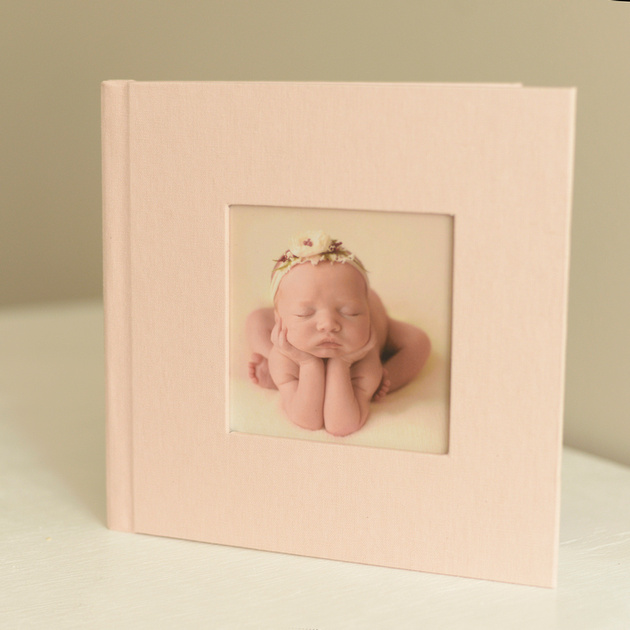 A photo album available as an add-on service to a newborn photography session with erica courtine photography in raleigh nc.