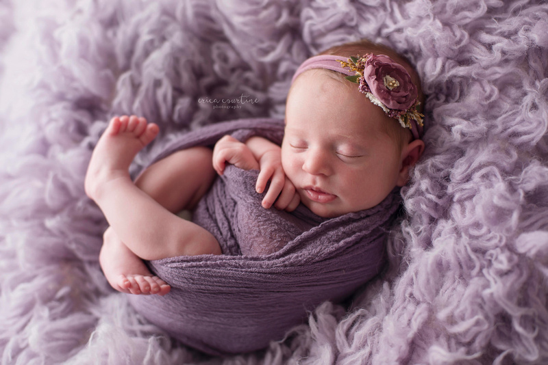 Raleigh NC Affordable Newborn Photographers a baby girl on a lavender float during a photo session.