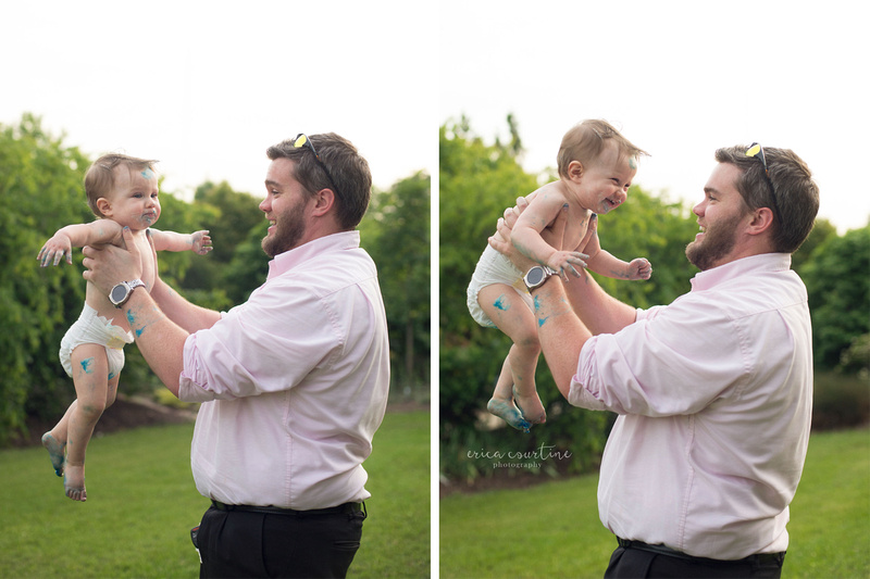 Daddy holds a dirty baby after a cake smash photo session at Raulston Arboretum in Raleigh NC.  By photographer Erica Courtine