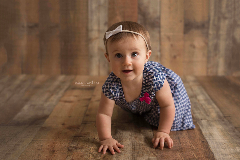 A baby crawling during a baby milestone mini session at Erica Courtine Photography studio in Fuquay Varina NC.