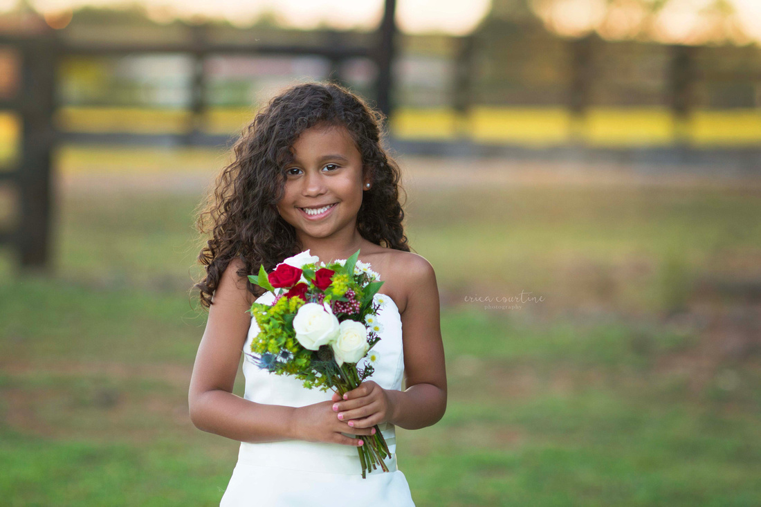 A little girl in her mom's wedding dress during a photography session in Holly springs, near Raleigh NC.