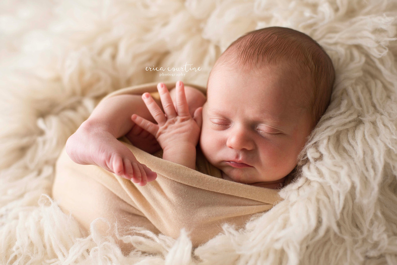 Swaddled baby during a newborn photography session in raleigh nc