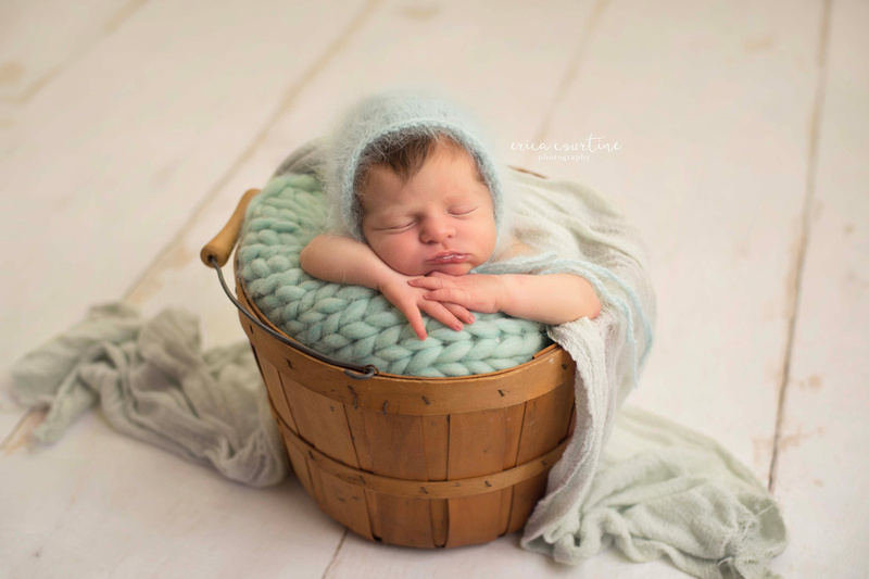 Baby in a bucket during a newborn session Raleigh Cary Apex Holly Springs Fuquay Varina NC