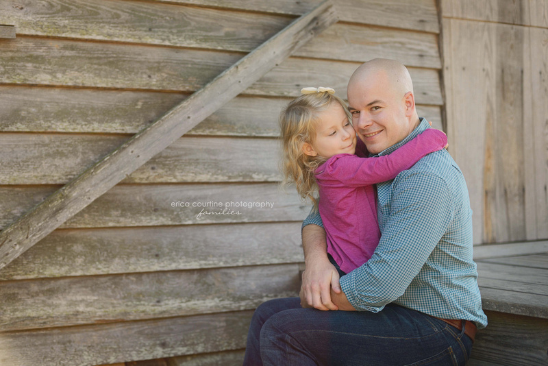 A father and daughter sit at Yates Mill County Park in Raleigh, NC during their family session with Erica Courtine Photography.