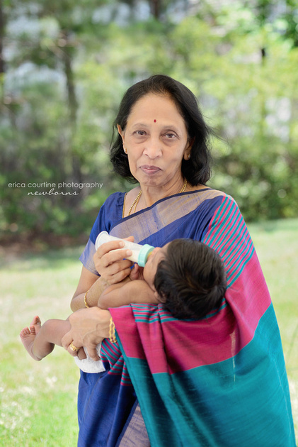 A grandmother holds her newborn granddaughter during a newborn photo session in Raleigh, NC.