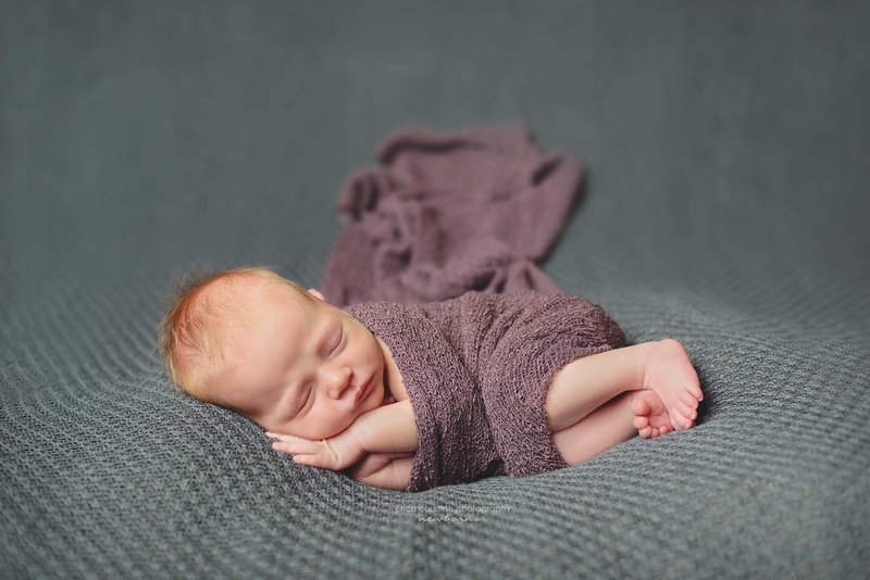 A natural, organic, pure newborn portrait of a baby girl on a teal blanket raleigh cary newborn photographer