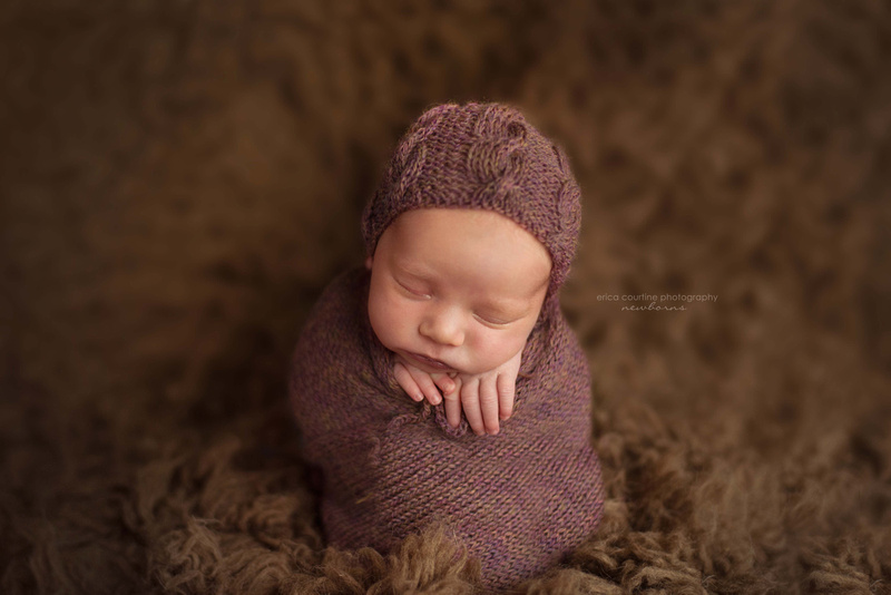 Sweet baby girl in neutral colors during a newborn portrait session in Holly Springs, NC