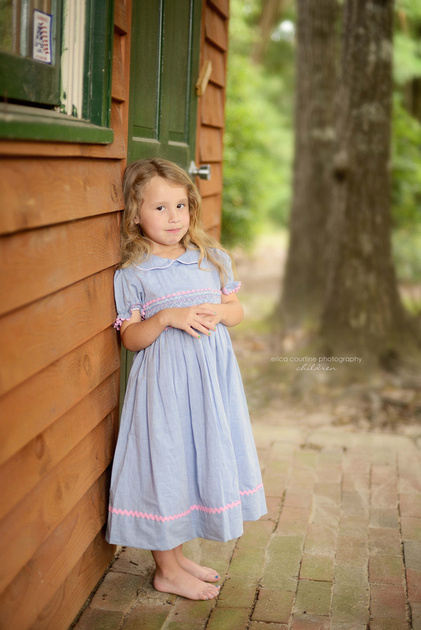 little girl plays in yard during child portrait session by raleigh area photographer Erica Courtine Photography