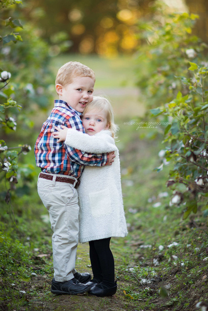 Fall Family Photographer in Raleigh NC captures a brother and sister in a cotton field at Oak View County Park.