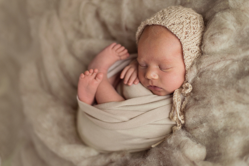 Raleigh NC Newborn Baby Photographer featuring in-home and outdoor newborn portrait sessions.