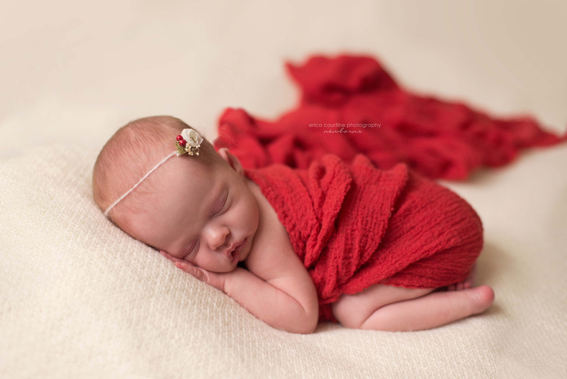 raleigh nc newborn portrait photographer a baby girl in red for christmas