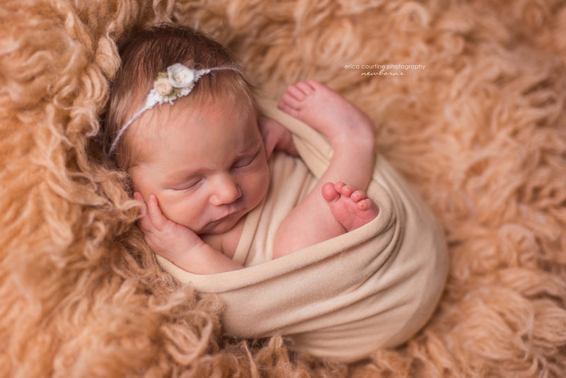 A baby girl in neutral colors during her newborn portrait session in Cary, NC