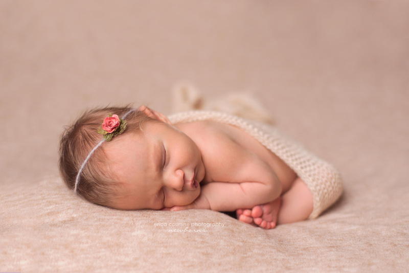 A baby girl in neutral colors during her newborn photography session in Cary, outside of Raleigh NC.