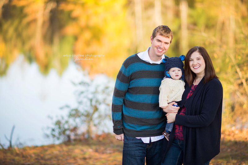 A family at Seagroves Farm Park in Apex, NC, during a family photo session.