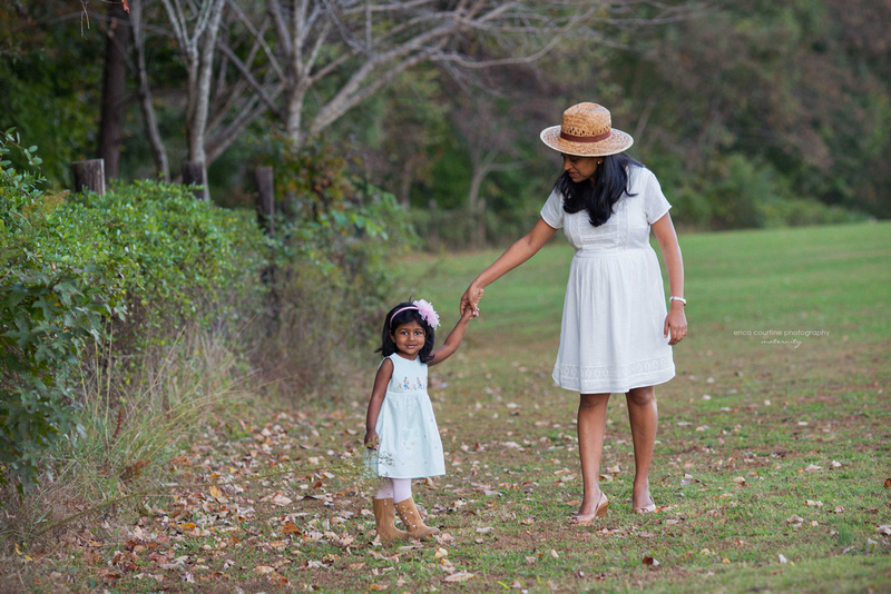 A mother and daughter walk together during a maternity photography session in Holly Springs NC.