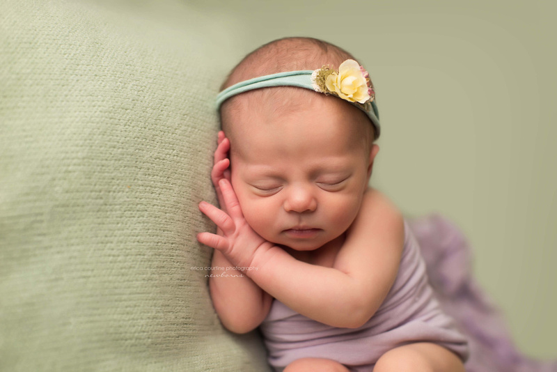 A baby girl during a newborn photo shoot with Erica Courtine Photography in Fuquay Varina outside of Raleigh NC.