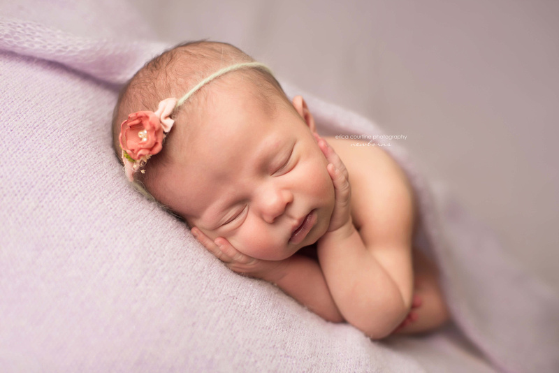 A sweet baby girl sleeps during a newborn photography session with Erica Courtine Photography in Raleigh NC.