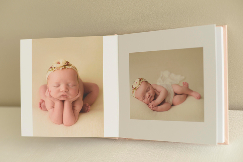 A photo album from a newborn photography session in raleigh nc.