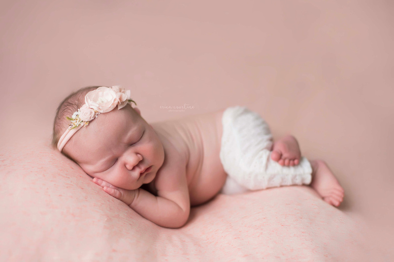 A newborn baby girl during a newborn photo shoot in Cary, outside of Raleigh, NC.  Digital images, prints, and birth announcements are included in all newborn sessions.
