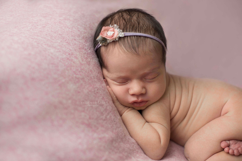 Twin baby girl during her newborn photography portrait session at home in Raleigh, NC.