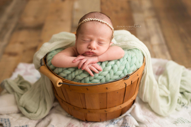 Baby girl in a basket at a newborn photography session in Fuquay Varina, near Raleigh, NC.