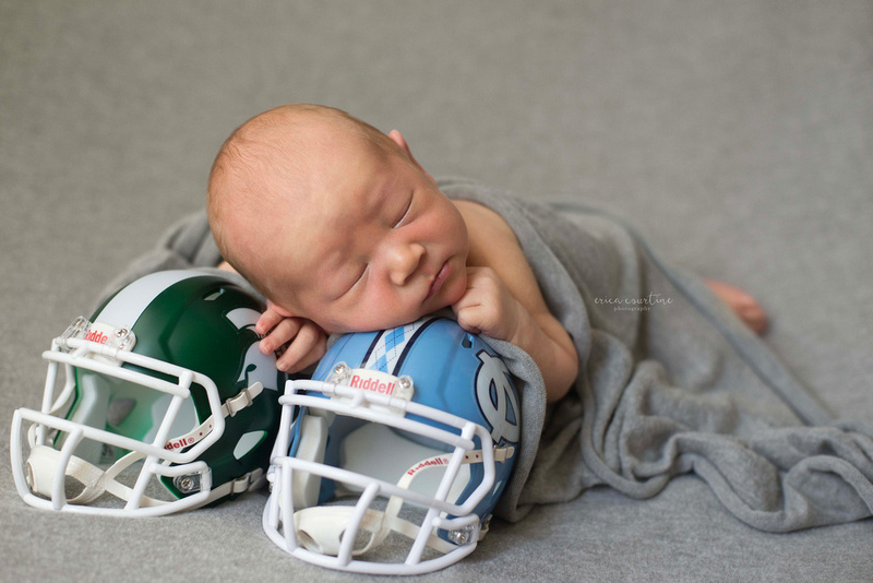 Sports themed football newborn photography portrait with unc football helmet.  raleigh cary apex holly springs fuquay varina nc newborn photographer
