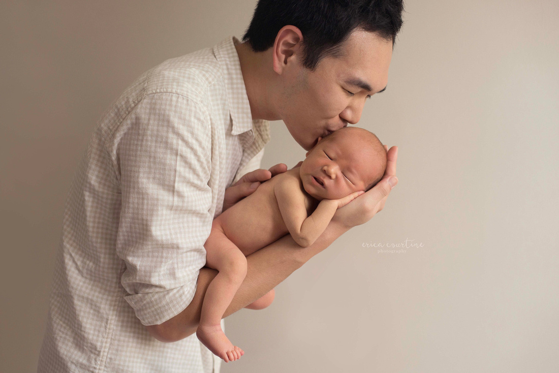 Dad and baby during a newborn photo session in Fuquay Varina, outside of Raleigh, NC.