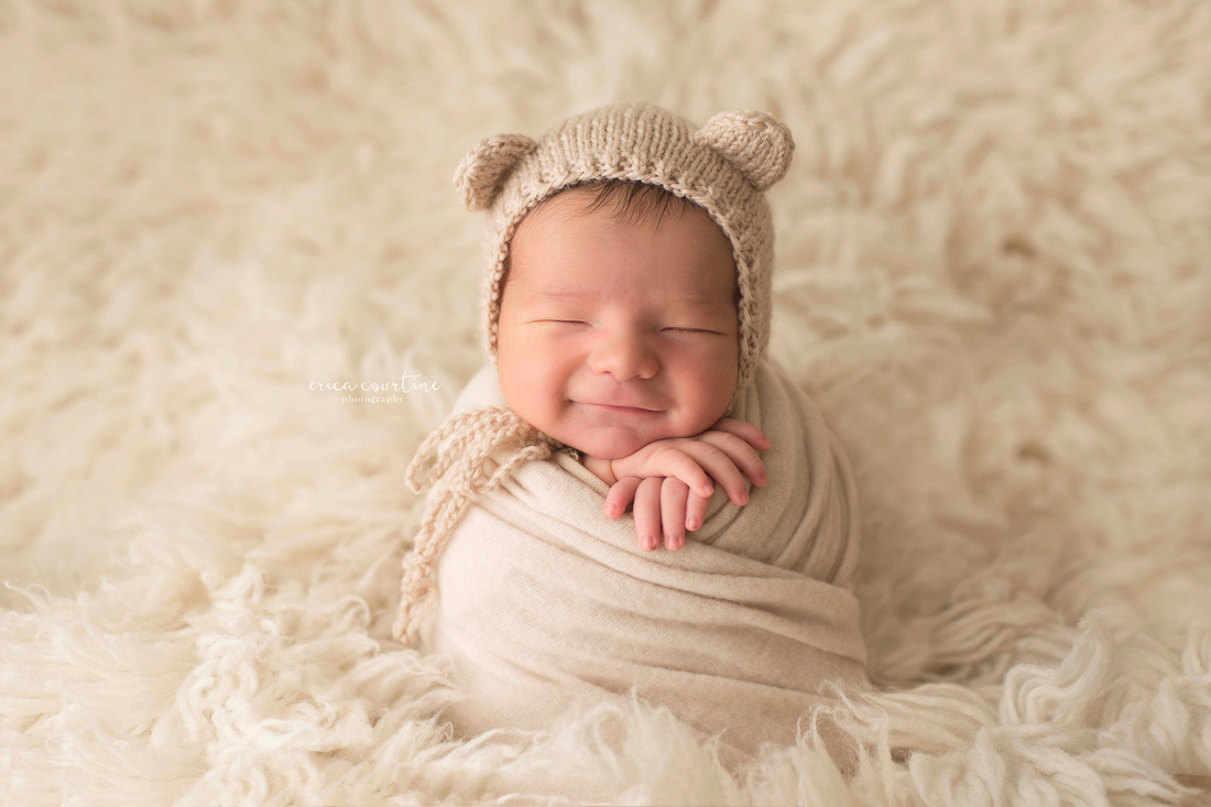 Potato sack pose during newborn photography session raleigh cary apex holly springs fuquay varina nc.