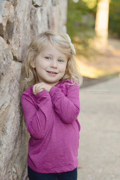 Three year old little girl during a family portrait session at Yates Mill County Park in Raleigh, NC.