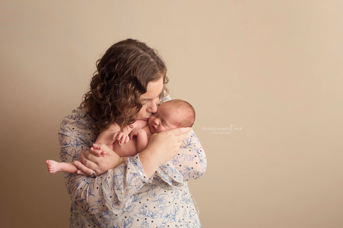 A mama and baby during a newborn photoshoot in fuquay varina outside of raleigh nc
