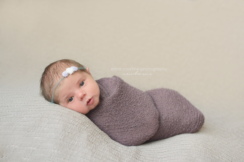 Beautiful newborn girl wide awake for her newborn photography session in cary nc