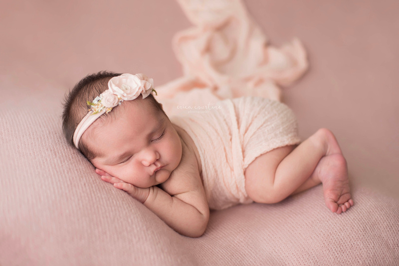 Newborn baby girl in rose pink during a portrait session at a studio in Fuquay Varina with digital packages with print release by photographer Erica Courtine