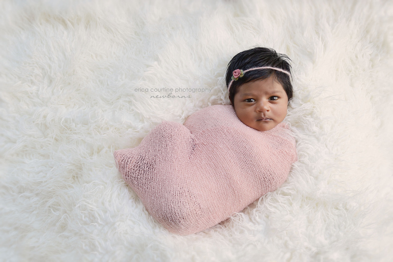 A baby girl looks at the camera during her newborn photography session in Raleigh, NC.