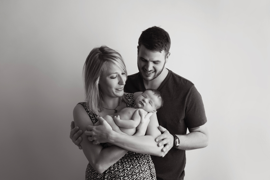 Family portraits during a newborn photography session in a Fuquay Varina studio, just south of Raleigh, NC.