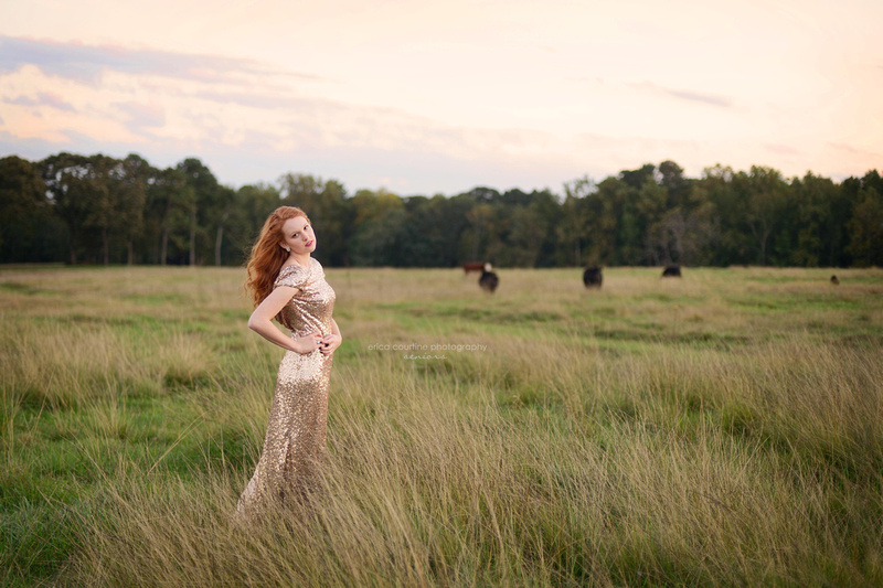 Raleigh NC family photographer does a senior portrait session on a farm in a field.
