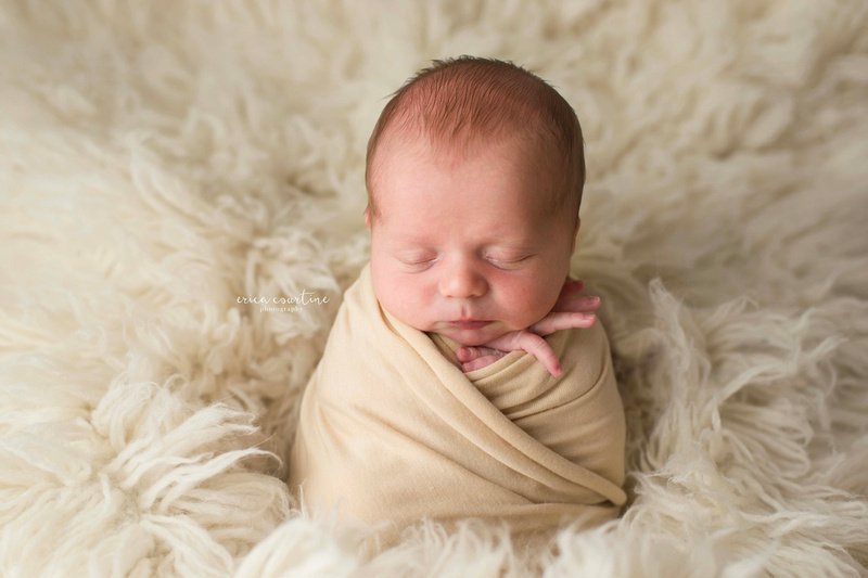 A little baby boy in pale yellow during a newborn photography session in raleigh nc.