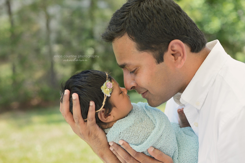 A new couple holds their newborn baby during their newborn portrait session in Durham, NC.